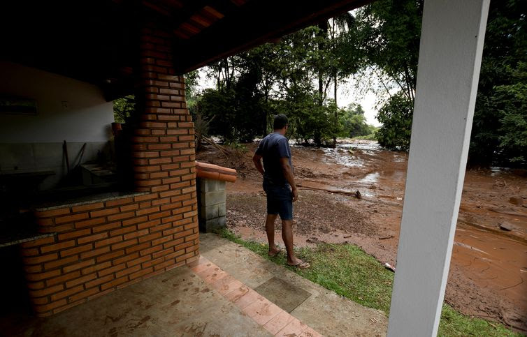 A resident is seen at his house after a dam, owned by Brazilian miner Vale SA, burst in Brumadinho, Brazil January 26, 2019. REUTERS/Washington Alves