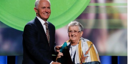 Sr Anne accepts her award from the PM