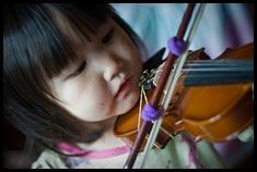 criança violino