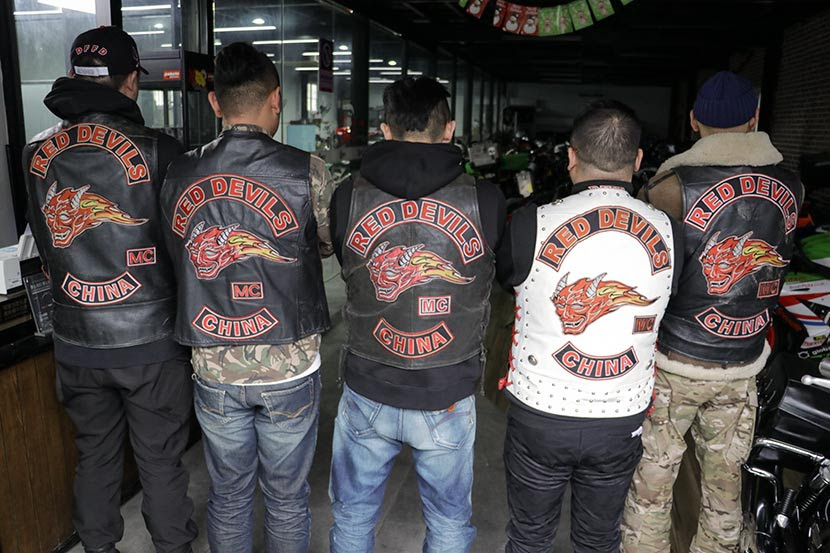 Red Devil members show off their club jackets in Shanghai, Jan. 27, 2018. Kenrick Davis/Sixth Tone