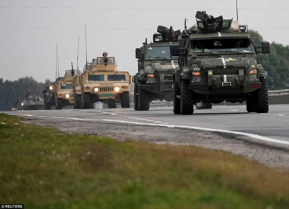 Military reaction: Armoured Personnel Carriers (APC) ride on the road near the warehouse