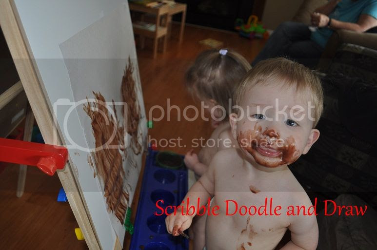 Toddler art activity painting with pudding