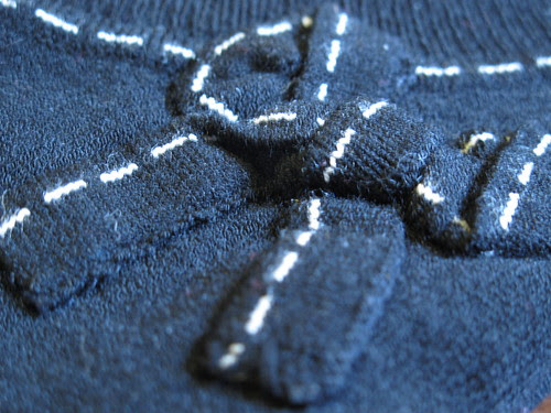 Stitched Bow Detail