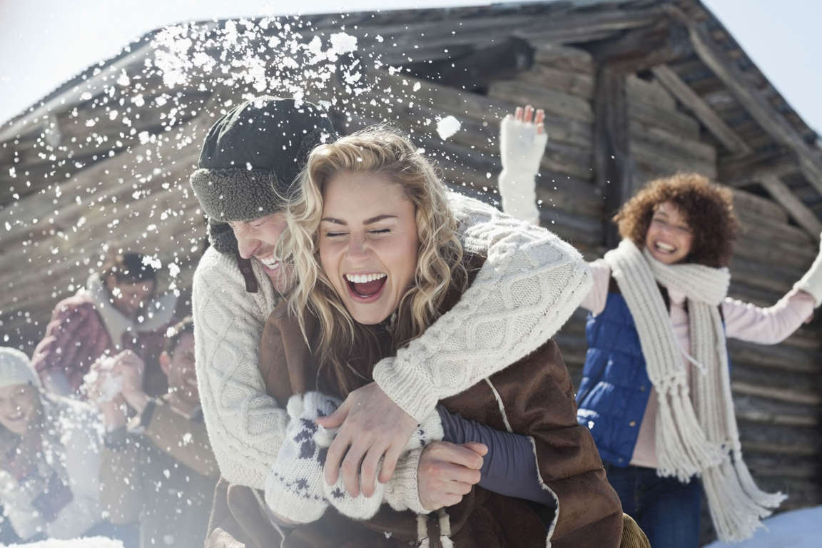 MODEL RELEASED Friends enjoing snowball fight, Les Diablerets, Switzerland