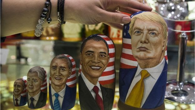 Traditional Russian wooden dolls depict US presidents, including president-elect Trump