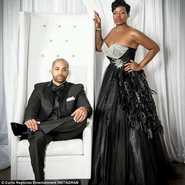 Dramatic: The couple posed for some very glamorous photos which Fantasia explained were displayed at her wedding reception