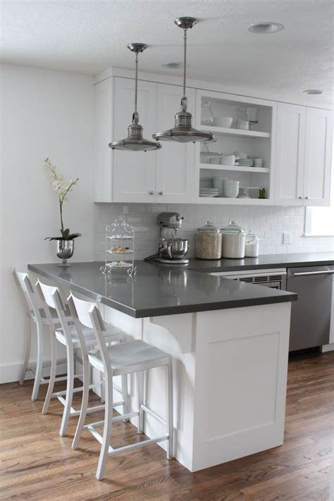 white cabinets subway tile quartz
