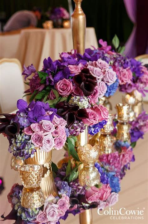 pink and purple flowers and gold glass containers wedding