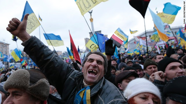 Pro-EU activists shout slogans during the rally in Independence Square on December 8.