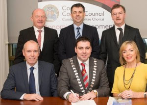 Mayor of the County of Cork Cllr. John Paul O' Shea signs the contract foe the new food incubation kitchen in Co Hall in the presence of Mary Daly, Food Safety Company and the Chief Executive of Cork County Council. Also included in the photo are staff from the Economic Development Unit of Cork County Council.
