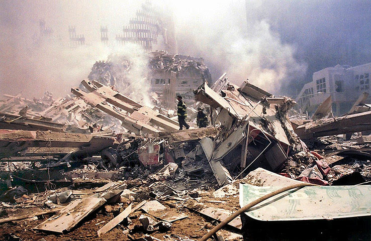 World Trade Centre 11 September 2001 Firemen walk around Ground Zero