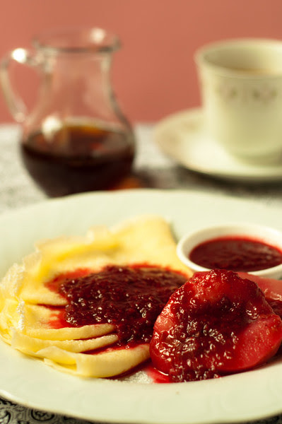 Crepes with stewed pears and raspberry sauce