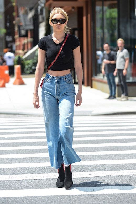 Le Fashion Blog Gigi Hadid Sunglasses Black Cropped Tee Mom Jeans Black Boots Via Vogue