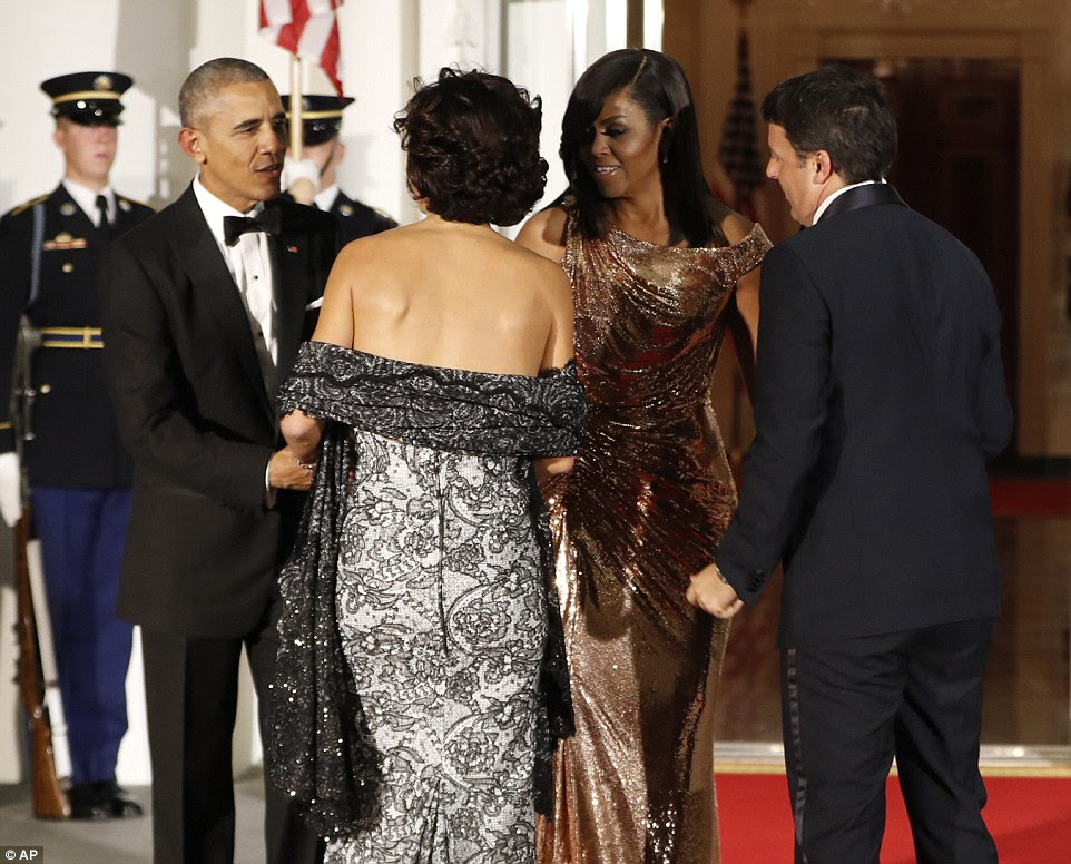 President Barack Obama and first lady Michelle Obama greet the Italian Prime Minister Matteo Renzi and his wife Agnese Landini on the North Portico before the State Dinner