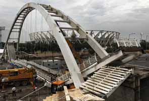 Commonwealth Games 2010 mess: Foot over-bridge at Nehru stadium collapses