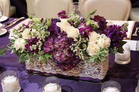 Round Wedding Table flowers eggplant   Tall arrangements