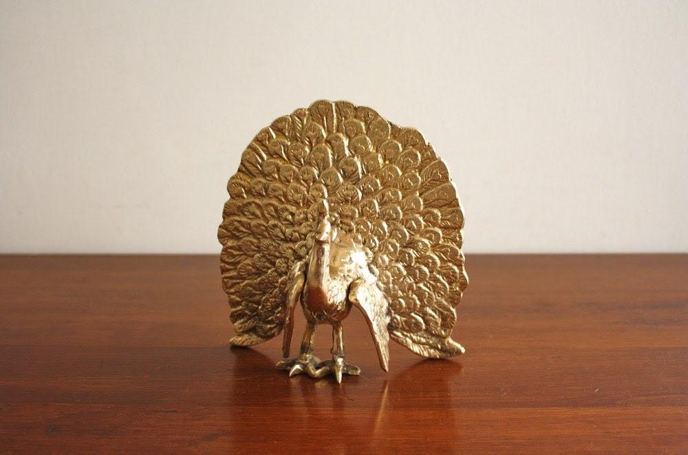 Vintage brass peacock