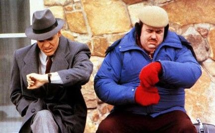 Neal Page and Del Griffith sitting on Del's trunk