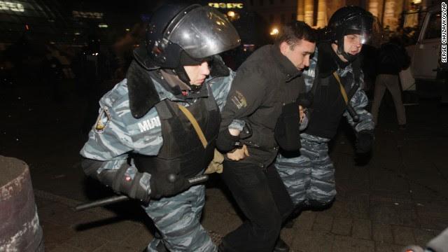 Ukrainian riot police officers detain a protester on November 30.