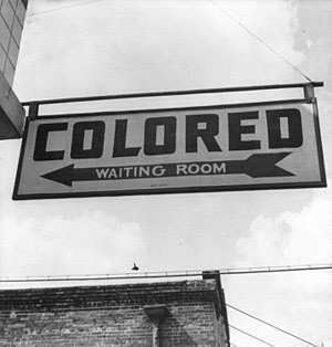 "Sign for ""colored"" waiting room at a..."