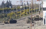 Syrian tanks are seen in Bab Amro near the city of Homs February 12, 2012.     REUTERS/Mulham Alnader/Handout