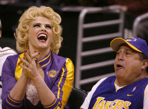 Smith and Danny DeVito clown around during a Los Angeles Lakers' game in 2004. Photo: CHRIS CARLSON, Associated Press