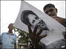 Staff members of Sunday Leader newspaper hold a portrait of editor Lasantha Wickramatunga in the suburbs of Colombo, Sri Lanka, Friday, Jan. 9, 2009