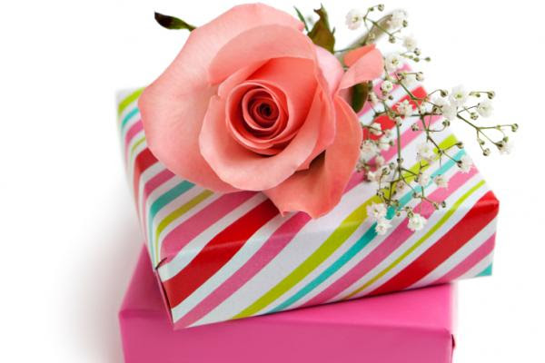 Gift boxes and pink rose.