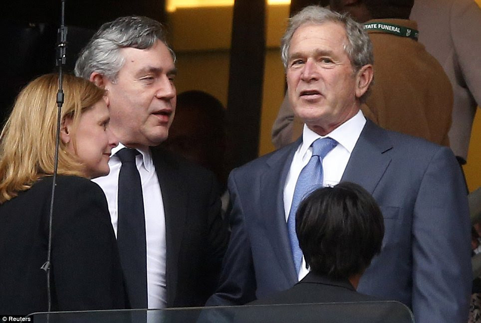 Support: Gordon Brown, who paid tribute to Mandela in the Commons yesterday, with his wife Sarah and George W. Bush