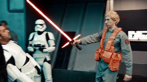 Matt, the radar technician shows off Kylo Ren's lightsaber to fellow First Order personnel in UNDERCOVER BOSS: STARKILLER BASE.