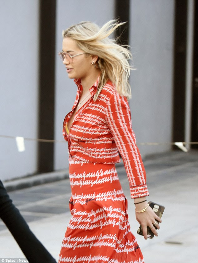 Not shy: The singer flashed a hint of her ample assets as she left a number of shirt buttons undone, adding a whole new layer of sexiness to her look