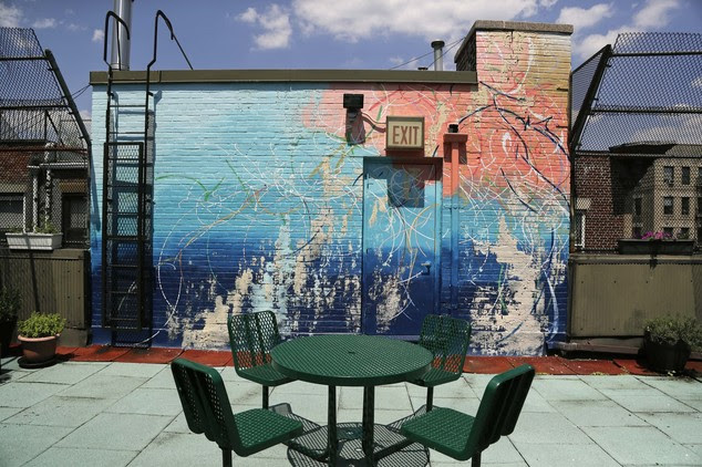 A mural painted by artist Jose Parla decorates a wall and entrance to a courtyard on top of the Incarnation Children's Center, Thursday, July 21, 2016, in Ne...