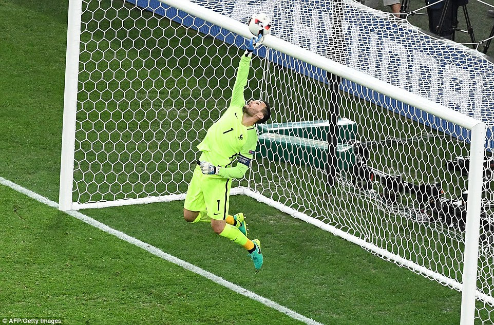 Lloris reaches up to push a long-range effort over the top of the crossbar as the Germans continued to dominate