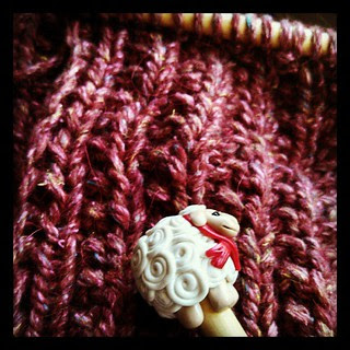 Day 8 Texture #yarnpadc Stitches of The Amelia #scarf in #DebbieBliss Winter Garden and my #sheep #knittingneedles