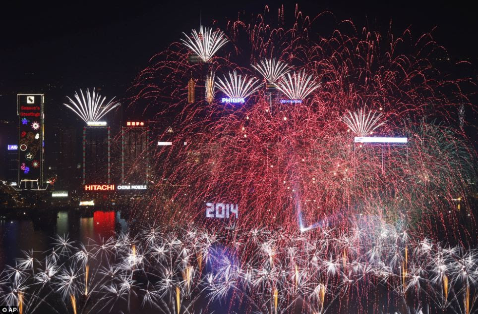 With fireworks erupting from the water and bursting high in the skies, Hong Kong's harbour was showered in sprays of red and white as midnight struck