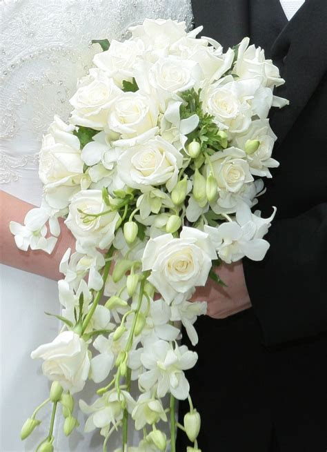 Roses and dendrobium orchids   Wedding Flowers   Cascading