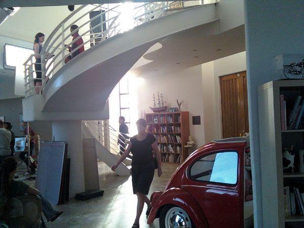 Filming inside the mansion's living room.