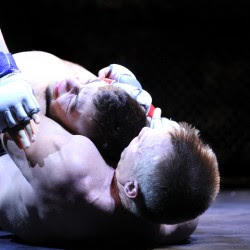 Patrick Kelly (bottom) puts a hold on Frank Dellasalla during a New England Fights bout Sept. 6 in Lewiston.