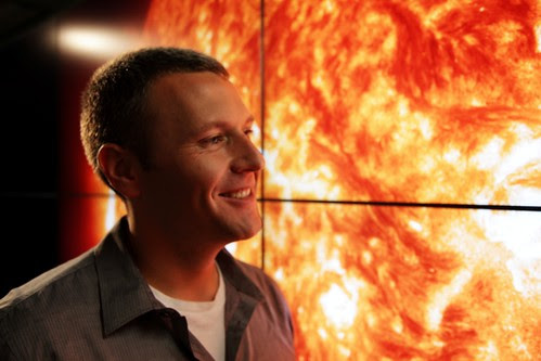 Dr. Karl Battams in front of the Hyperwall showing imagry of the Sun at Goddard Space Flight Center.(credit: Darlow Smithson Productions/Edward Watkins)