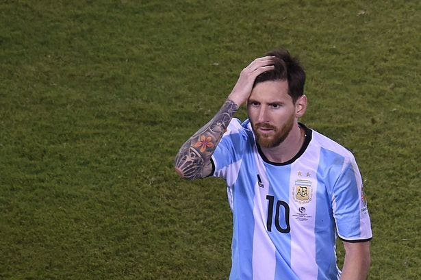 Argentina's Lionel Messi leaves the field after being defeated by Chile