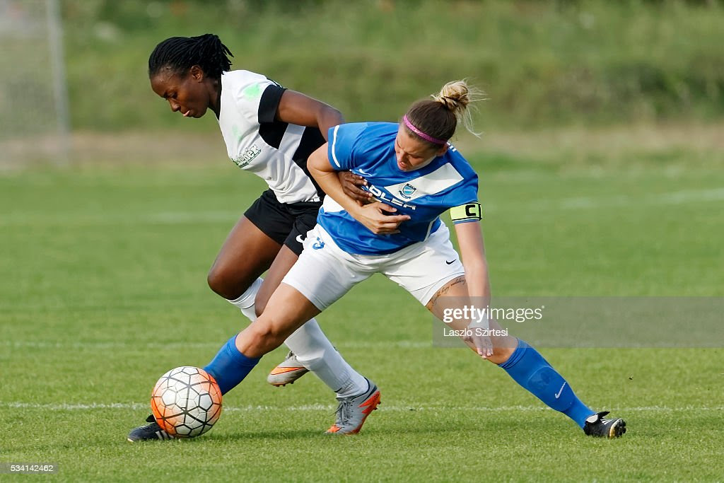 Reka Demeter (R) of MTK Hungaria FC tackles <a gi-track='captionPersonalityLinkClicked' href=/galleries/search?phrase=Ebere+Orji&family=editorial&specificpeople=7098554 ng-click='$event.stopPropagation()'>Ebere Orji</a> (L) of Ferencvarosi TC during the Women's Hungarian Jet-Sol Liga Final second leg match between MTK Hungaria FC and Ferencvarosi TC at BKV Stadium on May 23, 2016 in Budapest, Hungary.