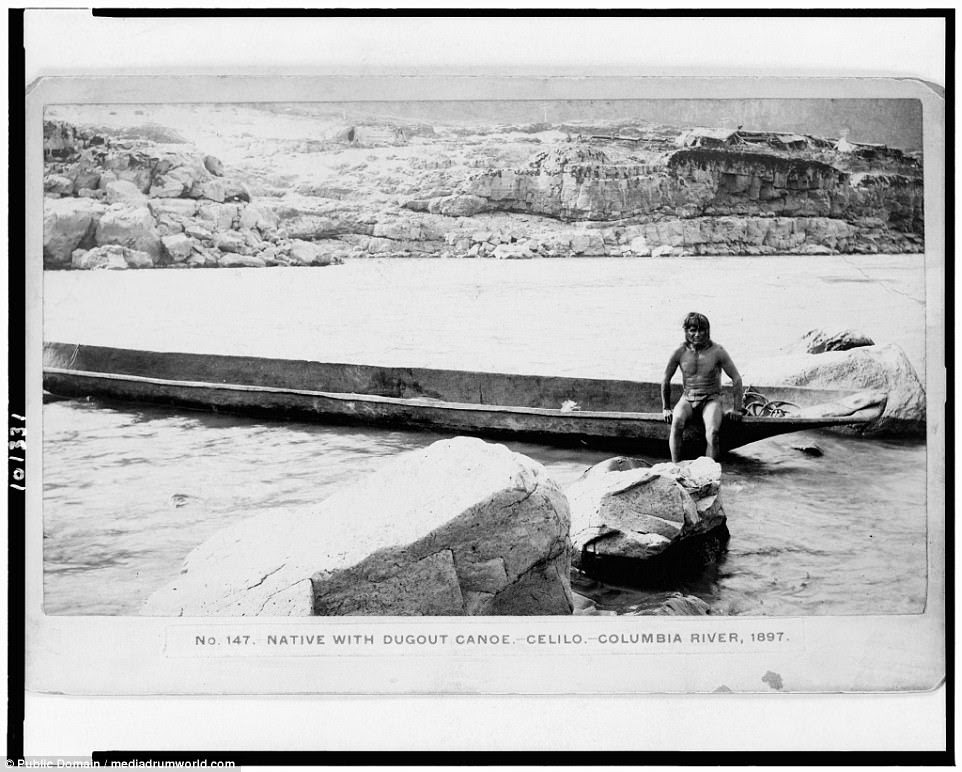 AWascoe Indian sits on a canoe he has fashioned, 1897. The tribe are from the Columbia River area of Oregon