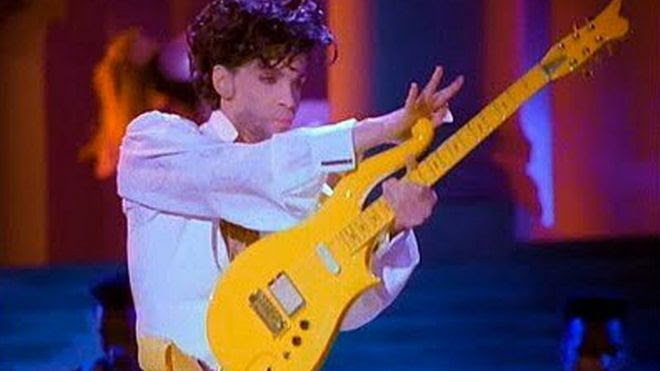 Photo provided by Heritage Auctions shows Prince playing his Yellow Cloud electric guitar