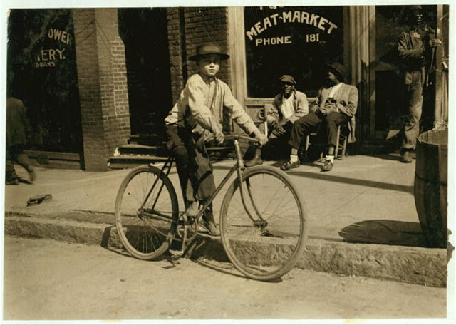 An 11 year old delivery boy for an Opelika meat market.  Location: Opelika, Alabama.