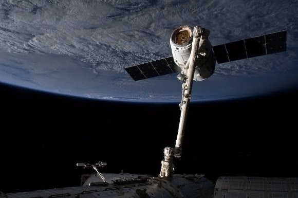 The SpaceX Dragon capsule is snared by the International Space Station's Canadarm 2. Credit: NASA