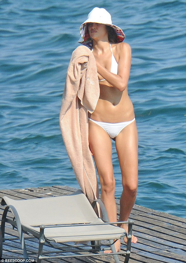 Looking good: The Russian star confidently showed off her enviable curves in the eye-catching swimwear