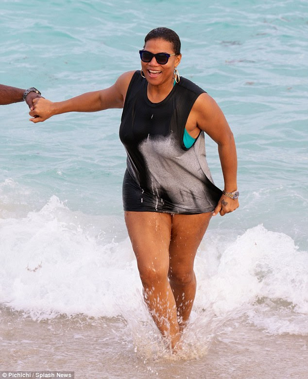 Splish splash! The 44-year-old star and her male pal held hands as they splashed through the water