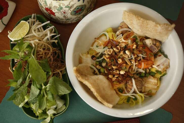 Mi Quang--Hofun noodle with pork, shrimp, and chicken--served at Da Nang Quan in Oakland, Calif., on Friday, October 30, 2015.