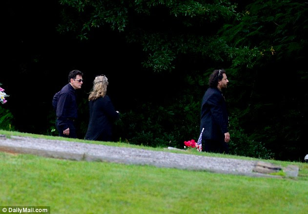 Intimate: Family of Julia Roberts arrive at New Smyrna Cemetery on Saturday for a ceremony to farewell the actresses mother, Betty Lou
