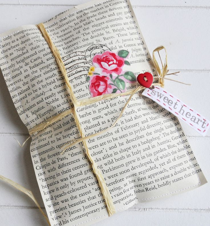 Sweet gift packet, decorate the outside with rubber stamps, flowers cut from rosy fabric or paper, then tie up with raffia and add a heart button and tag.